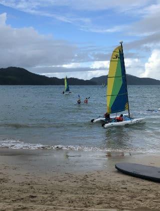 A catamaran on Catseye Beach Hamilton Island
